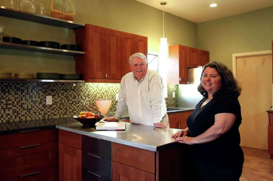 The Rezniceks wrapped up a six-month remodeling job of their kitchen in January. Before, they lived with pink laminate counters in a cramped space. Photo: HELEN L. MONTOYA, SAN ANTONIO EXPRESS-NEWS / hmontoya@express-news.net