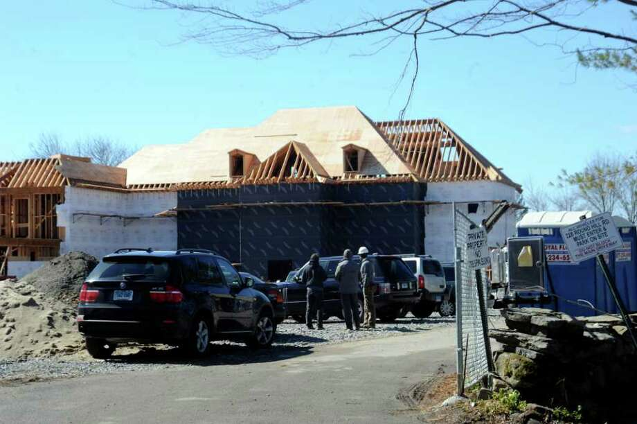 A worker was taken to Stamford Hospital with what is believed to be non-life threatening injuries after falling from scaffolding at a work site at 228 Round Hill Road Monday morning. An investigator from the federal Occupational Safety and Health Administration is investigating. Photo: Helen Neafsey / Greenwich Time