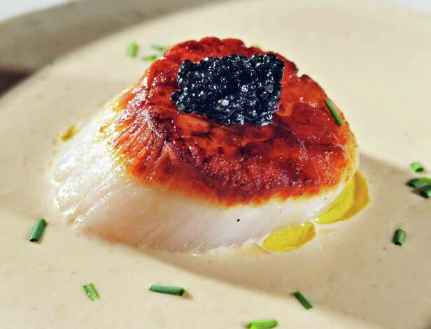 A scallop appetizer in oyster broth with caviar at MezzeNotte restaurant in Guilderland Friday afternoon 2/18/11.   (John Carl D'Annibale / Times Union) Photo: John Carl D'Annibale / 00012131A