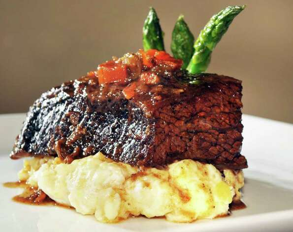 Boneless beef short ribs at MezzaNotte restaurant in Guilderland Friday afternoon 2/18/11.   (John Carl D'Annibale / Times Union) Photo: John Carl D'Annibale / 00012131A