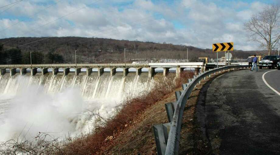 """People pull over to witness the raging water at Stevenson Dam in Oxford, Conn. on Monday, March 7, 2011. The Stevenson Dam in Oxford """"is wide open and out of control,'' Fire Chief Scott Pelletier said. """"Water is just pouring over.'' Photo: Cathy Zuraw / Connecticut Post"""