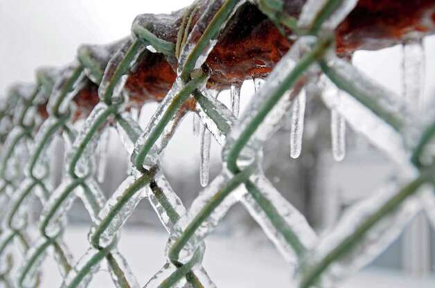 Ice covers a chain link fence in Colonie, NY on March 7, 2011.  (Lori Van Buren / Times Union) Photo: Lori Van Buren