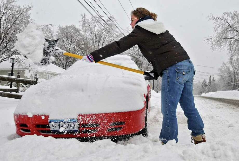 Michelle Duclose digs out her car, parked on the street in front of her home in Colonie, NY, on March 7, 2011.  (Lori Van Buren / Times Union) Photo: Lori Van Buren