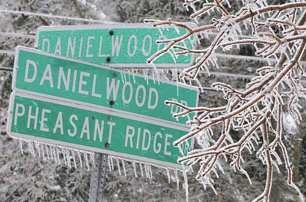 Ice covers tree branches and hangs from street signs in Colonie, NY, on March 7, 2011.  (Lori Van Buren / Times Union) Photo: Lori Van Buren