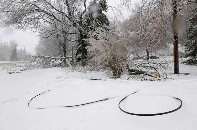 Broken  tree branches caused by an ice and snow storm brought down cable wires in Center Brunswick, NY, on March 7, 2011.  (Lori Van Buren / Times Union) Photo: Lori Van Buren