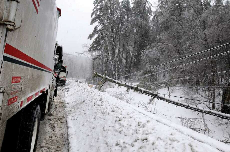 A fallen tree brought down electric, cable and telephone lines along Route 7 in Hoosick, NY, on Monday, March 7, 2011. Many residents and businesses in this area were out of these services due to an ice and snow storm.  (Lori Van Buren / Times Union) Photo: Lori Van Buren