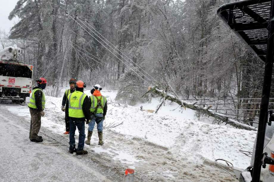 A fallen tree brought down electric, cable and telephone lines along Rt. 7 in Hoosick, NY on Monday, March 7, 2011. Many residents and businesses in this area were out of these services due to a ice and snow storm.  (Lori Van Buren / Times Union) Photo: Lori Van Buren