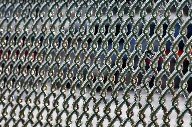 View of a chain link fence covered in ice on Monday, Mach. 7, 2011 in Colonie, NY. ( Philip Kamrass / Times Union ) Photo: Philip Kamrass