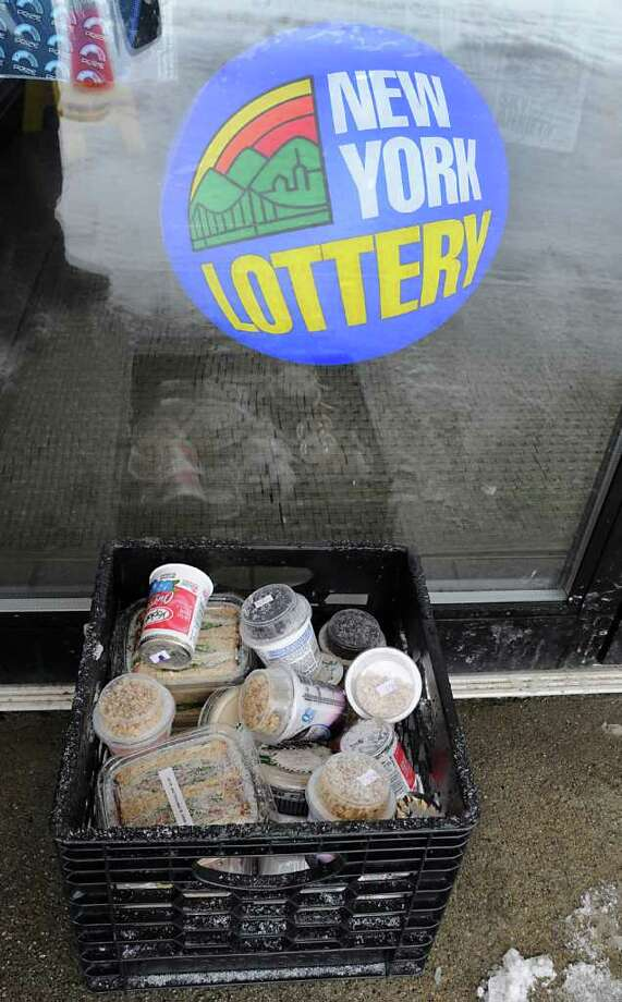 Perishables are kept outside a Sunoco/Dunkin Donuts Store on Route 7 in Hoosick, NY,  on March 7, 2011, to keep them cool. The store has been out of power since Sunday night.  (Lori Van Buren / Times Union) Photo: Lori Van Buren