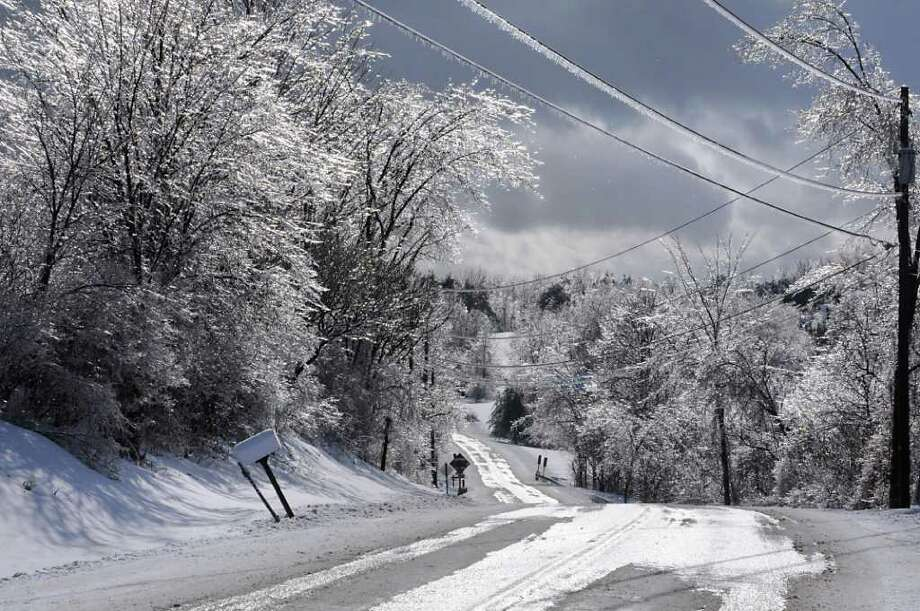 Ice covers tree branches and hangs from wires on Route 129 in Boyntonville, NY, Rensselaer County on Monday, March 7, 2011.  (Lori Van Buren / Times Union) Photo: Lori Van Buren