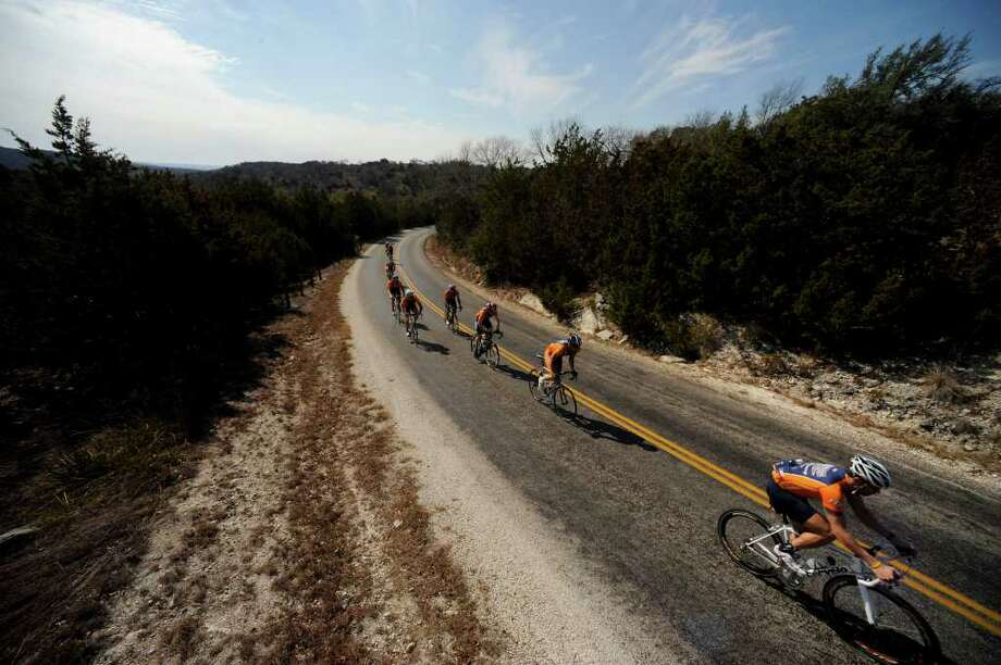 The Hill COuntry 600 will take riders through scenic and rugged countryside in Central Texas. These bicycles riders are training on a highway between Comfort and Fredericksburg. EXPRESS-NEWS FILE PHOTO Photo: BAHRAM MARK SOBHANI, Msobhani@express-news.net / San Antonio Express-News