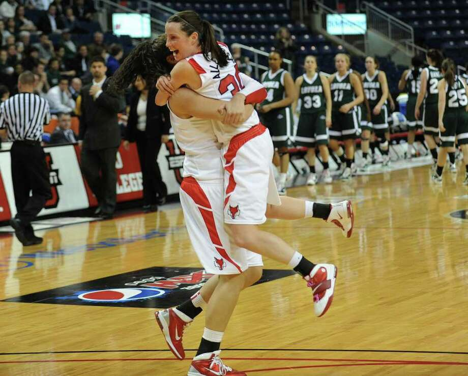 Tournament MVP Erica Allenspach leaps into the arms of her teammate Maria Laterza after Marist defeats Loyola in the finals of the MAAC conference tournament at the Webster Bank Arena at Harbor Yard in Bridgeport on Monday, March 7, 2011. Photo: Brian A. Pounds / Connecticut Post