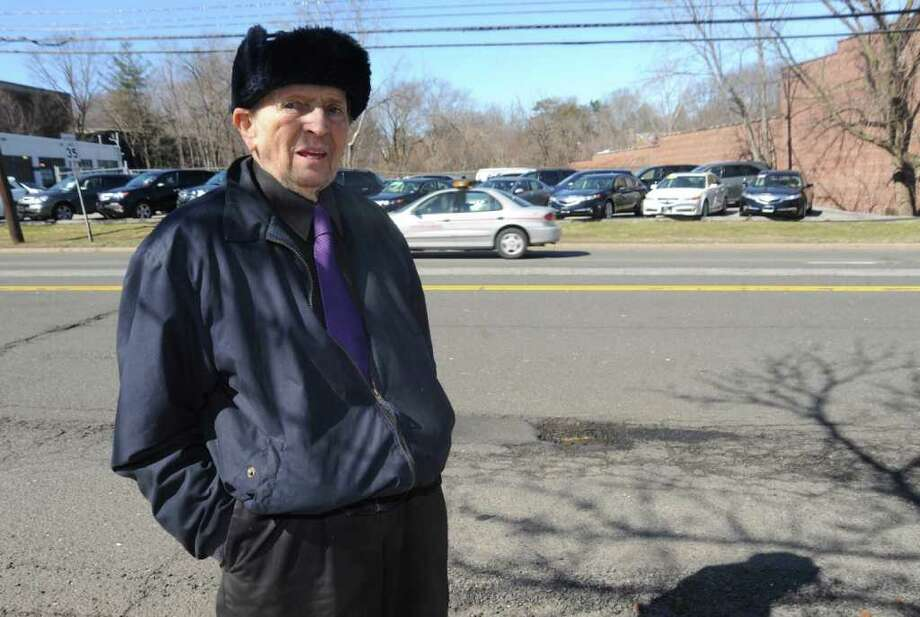 Bill Connolly, of Greenwich, is complaining of potholes along West Putnam Avenue near the former Horseneck Tavern, on Monday, March 7, 2011. Photo: Helen Neafsey / Greenwich Time