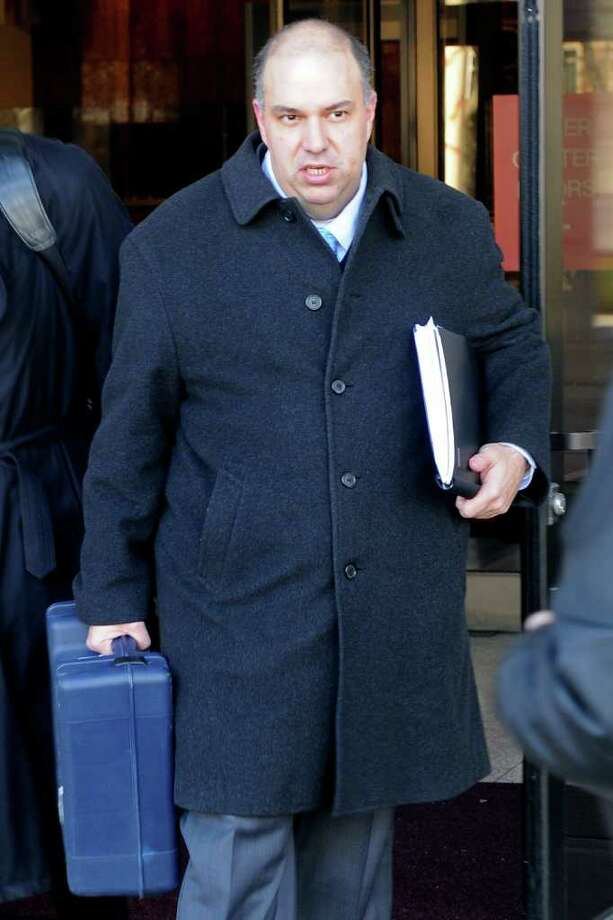 Francisco Illarramendi leaves Federal Court in Bridgeport, Conn. Monday, March, 7th, 2011, where he plead guilty to five counts involving investment advising and securities fraud. Photo: Ned Gerard / Connecticut Post