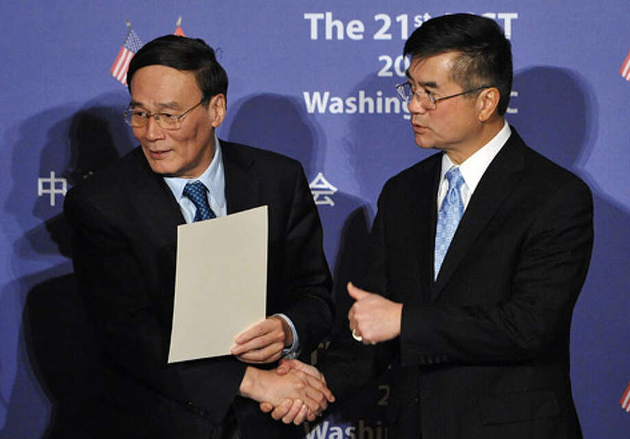 Chinese Vice Premier Wang Qishan (left) shakes hands with U.S. Commerce Secretary Gary Locke ahead of a signing ceremony at the 21st session of the US-China Joint Commission on Commerce and Trade on December 15, 2010 at the Andrew W. Mellon Auditorium in Washington, DC. Photo: MANDEL NGAN/AFP/Getty Images