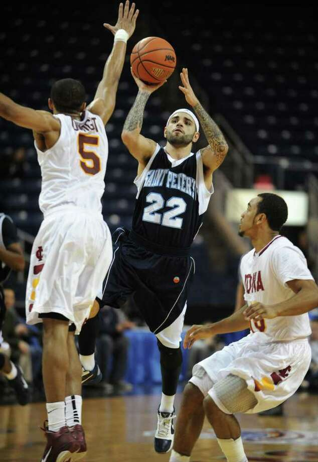 St. Peter's Nick Leon shoots a running jumper over Iona's Rashon Dwight during the MAAC championship game at the Webster Bank Arena at Harbor Yard in Bridgeport on Monday, March 7, 2011. Photo: Brian A. Pounds / Connecticut Post