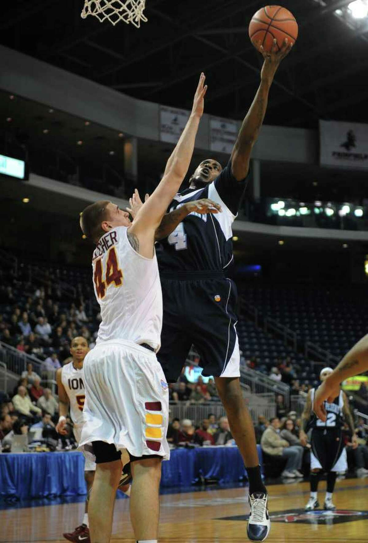 St. Peter's Ryan Bacon shoots over Iona's Chris Pelcher during the MAAC championship game at the Webster Bank Arena at Harbor Yard in Bridgeport on Monday, March 7, 2011.