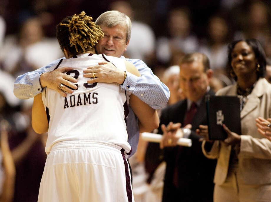 Texas A&M's Danielle Adams hugs coach Gary Blair on Senior Day. The Aggies are the reigning Big 12 champs. Photo: Jon Eilts/Associated Press