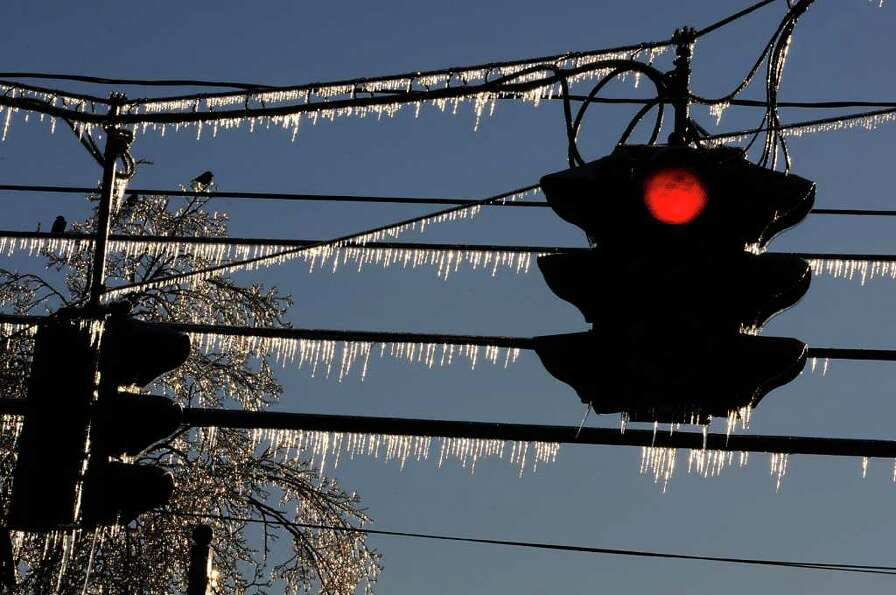 Ice hangs from traffic signal wires on Albany Shaker Rd. in Colonie, NY on Monday, March 7, 2011.  (