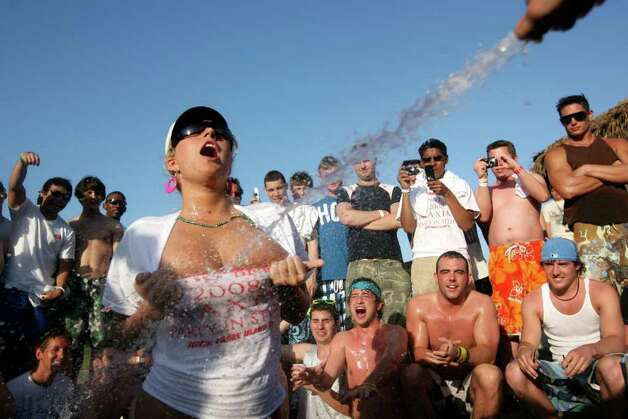SOUTH PADRE ISLAND, TX - MARCH 26:  Students participate in a wet t-shirt contest at the MTV Beach Bash party put on by Global Groove at the Bahia Mar Hotel at South Padre Island, Texas March 26, 2008 during the annual ritual of Spring Break.  The South Texas island is one of the top Spring Break destinations and attracts students from all over the country. Photo: Rick Gershon, Getty Images / 2008 Getty Images