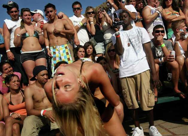 SOUTH PADRE ISLAND, TX - MARCH 26:  Students participate in a booty shaking contest at the MTV Beach Bash party put on by Global Groove at the Bahia Mar Hotel at South Padre Island, Texas March 26, 2008 during the annual ritual of Spring Break.  The South Texas island is one of the top Spring Break destinations and attracts students from all over the country. Photo: Rick Gershon, Getty Images / 2008 Getty Images