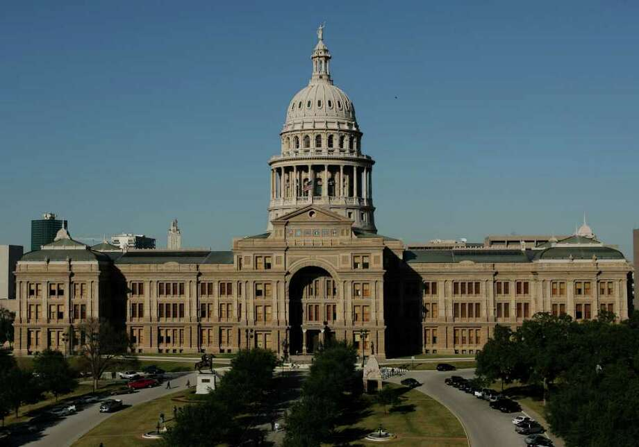 The Texas Capitol is shown Monday, Jan. 8, 2007, in Austin, Texas. Passage of a state budget is the only thing the Legislature is required to do in its 140-day regular session that convenes Tuesday, Jan. 9, 2007. It is in the House Chamber where members will vote Tuesday, the opening day of the 80th Legislature, to either keep Speaker Tom Craddick, R-Midland, or oust him in favor of a new leader. Photo: Harry Cabluck, AP / AP