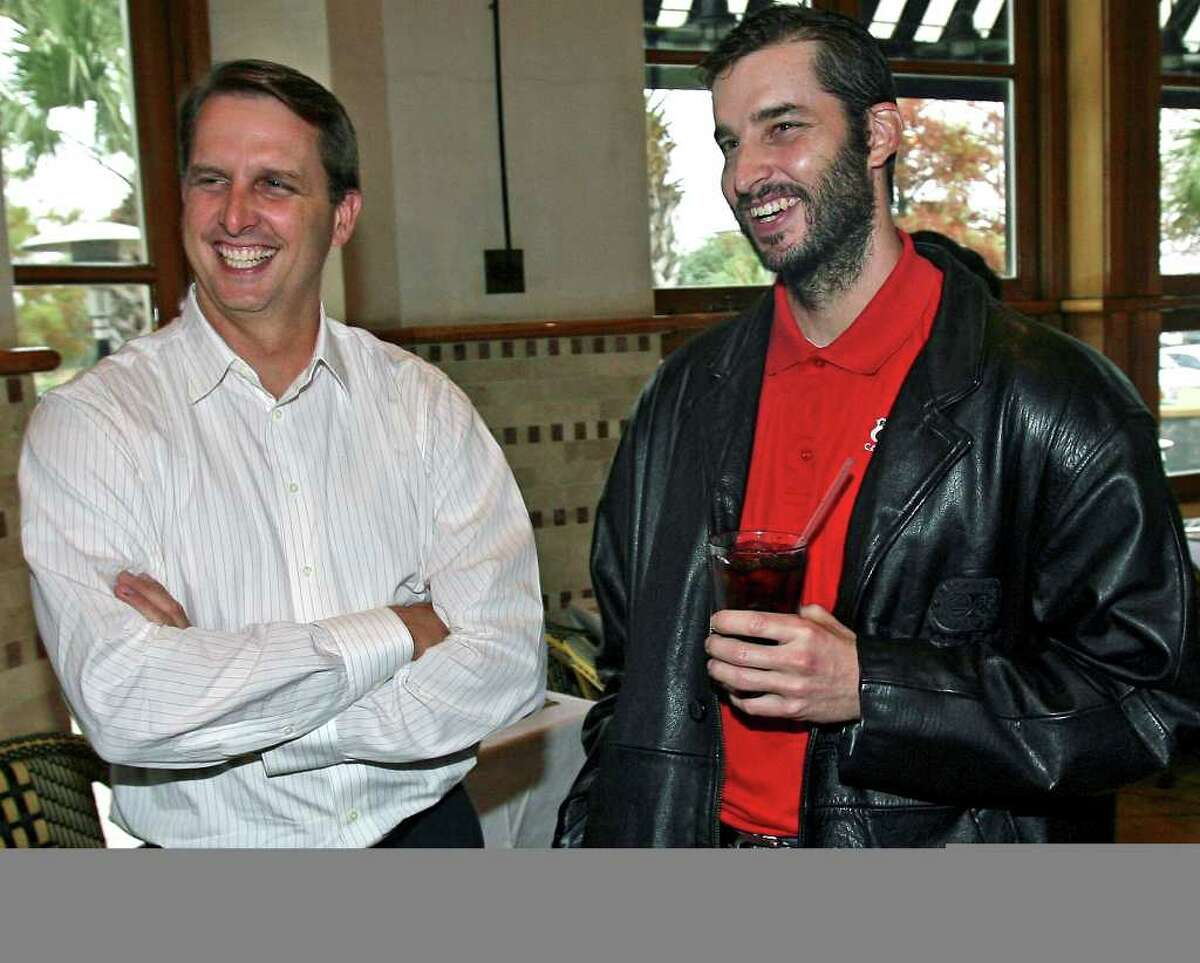 Sports Ty Detmer (left) and Koy Detmer greet members of the media at a lucheon at Reggiano's Wednesday to announce the opening of their new workout center. Ty Detmer and Koy Detmer at Reggiano's restaurant with Earl Campbell, Jesse James Leija. Announcing Triton Sports Center. Tom Reel/Staff December 12, 2007.