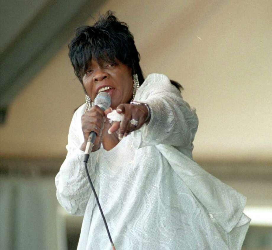FILE KoKo Taylor & her Blues Machine perform on stage at the New Orleans Jazz and Heritage Festival in this April 28, 2001 file photo. The blues singer  was reported in fair condition Tuesday, Jan. 29, 2002 at Northwestern Memorial Hospital in Chicago, two days after fainting at her South Side nightclub. The 66-year-old singer's blood pressure and blood sugar level had gone up after she failed to take medication for diabetes. She was expected to be released later this week. (AP Photo/Times-Picayune, Ric Francis) Photo: RIC FRANCIS, MBR / San Antonio Express-News