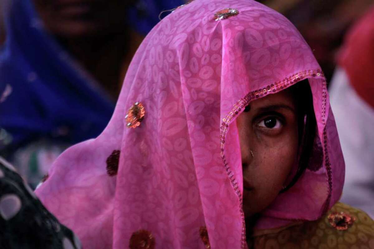 A member of the National Federation of Indian Women participates in a rally to mark International Women's Day in New Delhi, India, Tuesday, March 8, 2011. International Women's Day is being marked across the world Tuesday.