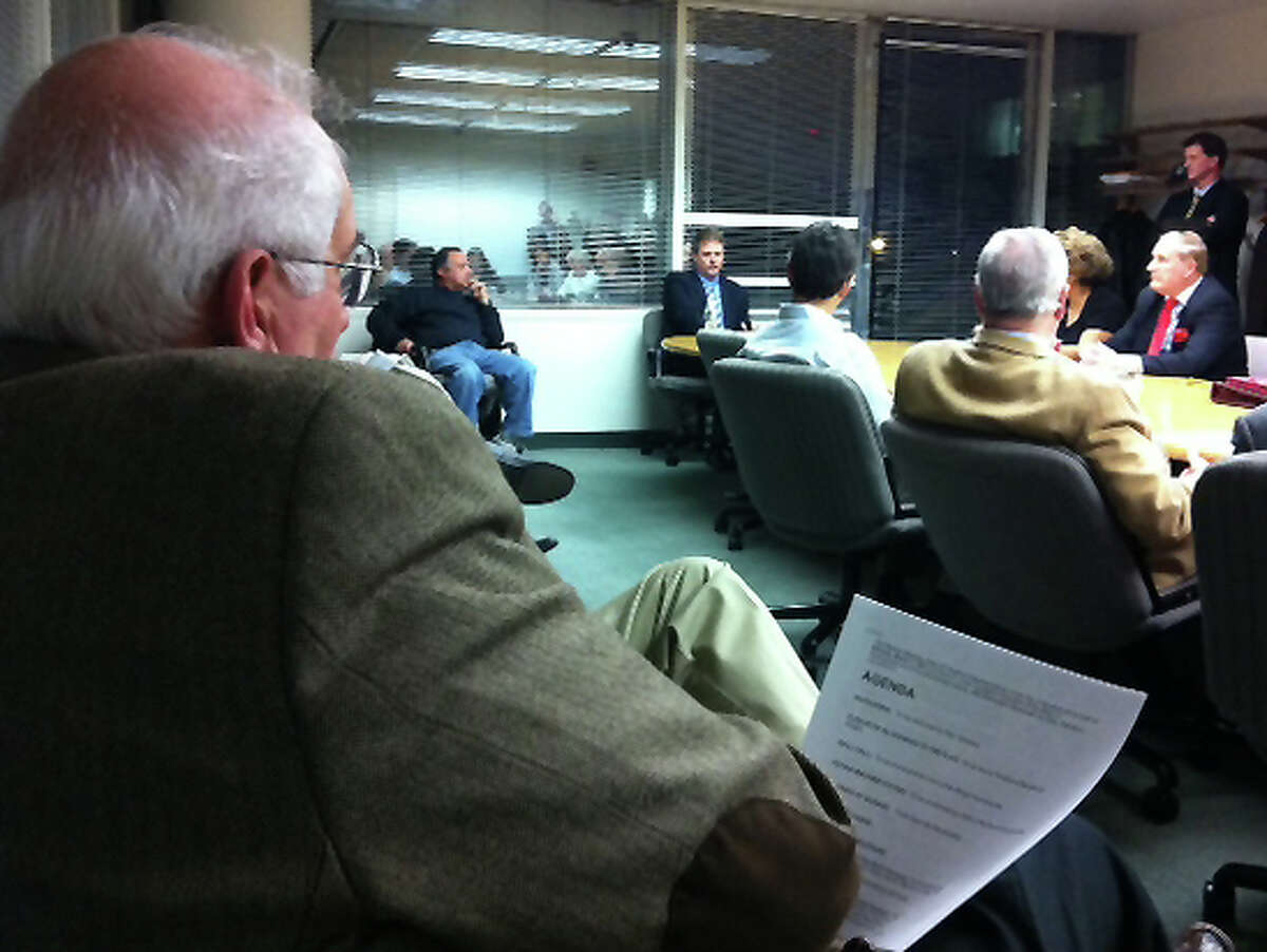 Former Board of Finance Chairman Joe Tarzia, left, watches Monday night as the Board of Representatives Appointments Committee interviews Kieran Ryan, center, for the Board of Finance seat Tarzia vacated.