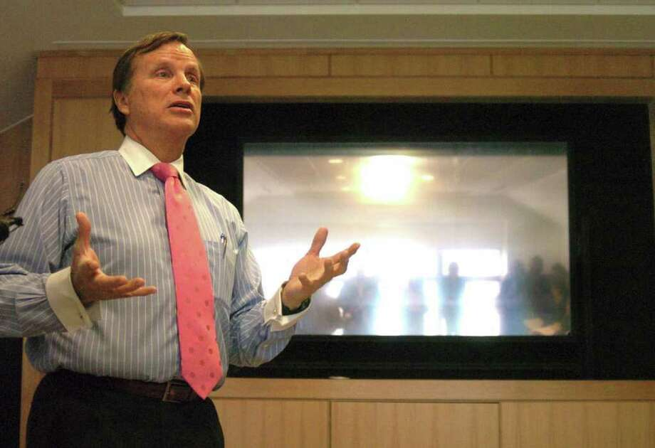 Alan Gray, assistant director of operations the Darien Library, shows off a projector in the conference and board room, one of many new additions that has been enjoyed by the public since the new library building opened in 2009. That story of how a state-of-the-art institution came to be, after a 10-year effort, has been documented by filmmaker Manny Perez's with his work, 'The Darien Library: The Great Good Place.' Photo: File Photo / Stamford Advocate File Photo