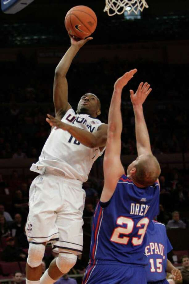 Connecticut's Kemba Walker goes to the basket against DePaul's Jimmy Drew (23) during the second half of an NCAA college basketball game at the Big East Championship, Tuesday, March 8, 2011 at Madison Square Garden in New York. (AP Photo/Mary Altaffer) Photo: Mary Altaffer, AP / Associated Press