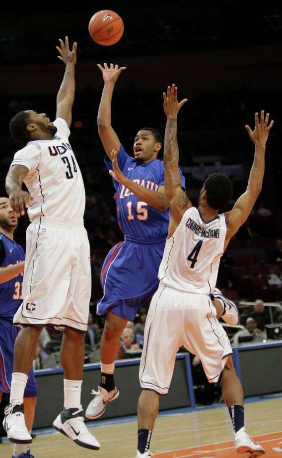 De Paul's Moses Morgan (15) goes to the basket against Connecticut's Alex Oriakhi (34) and Jamal Coombs-McDaniel (4)  during the first half of an NCAA college basketball game at the Big East Championship, Tuesday, March 8, 2011, at Madison Square Garden in New York.  (AP Photo/Mary Altaffer) Photo: Mary Altaffer, AP / Associated Press