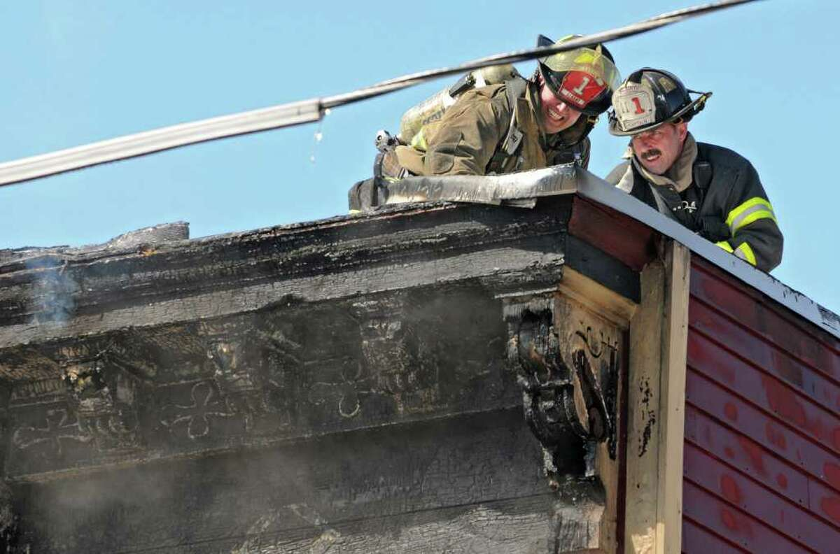 Albany firefighters put out a fire at 139 Dove St. in Albany, NY, on Tuesday, March 8, 2011. (Lori Van Buren / Times Union)