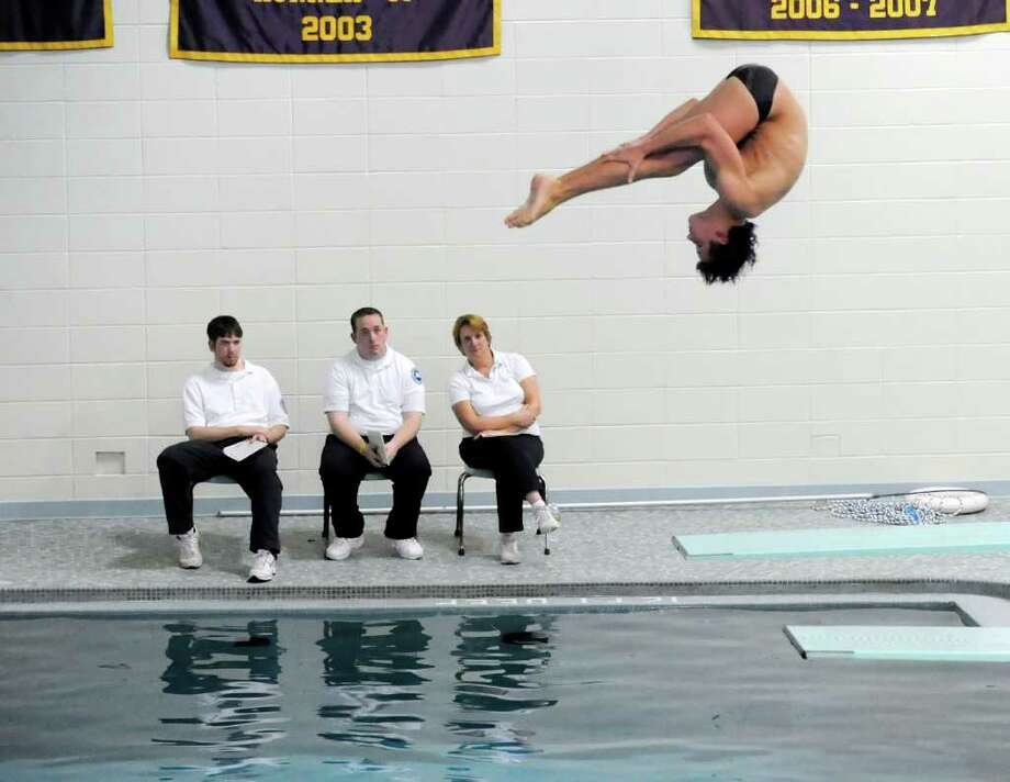 Connor Brisson of Greenwich High School during FCIAC Diving Finals at Westhill High School, Wednesday night, March 2, 2011. Photo by Bob Luckey 3/3/11 GT photo = Diving. Brisson sets league record to win title. by Tom Forde Photo: Bob Luckey, Greenwich Time / Greenwich Time