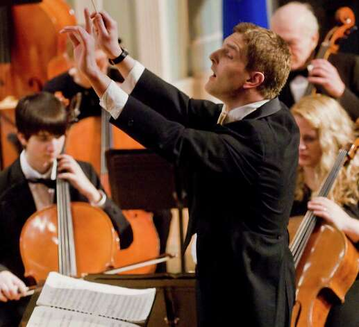 Ariel Rudiakov conducts the Danbury Symphony, which is among several groups that will perform in a special concert March 13 to celebrate the 75th anniversary of The Danbury Music Centre. Photo: Scott Mullin / The News-Times Freelance