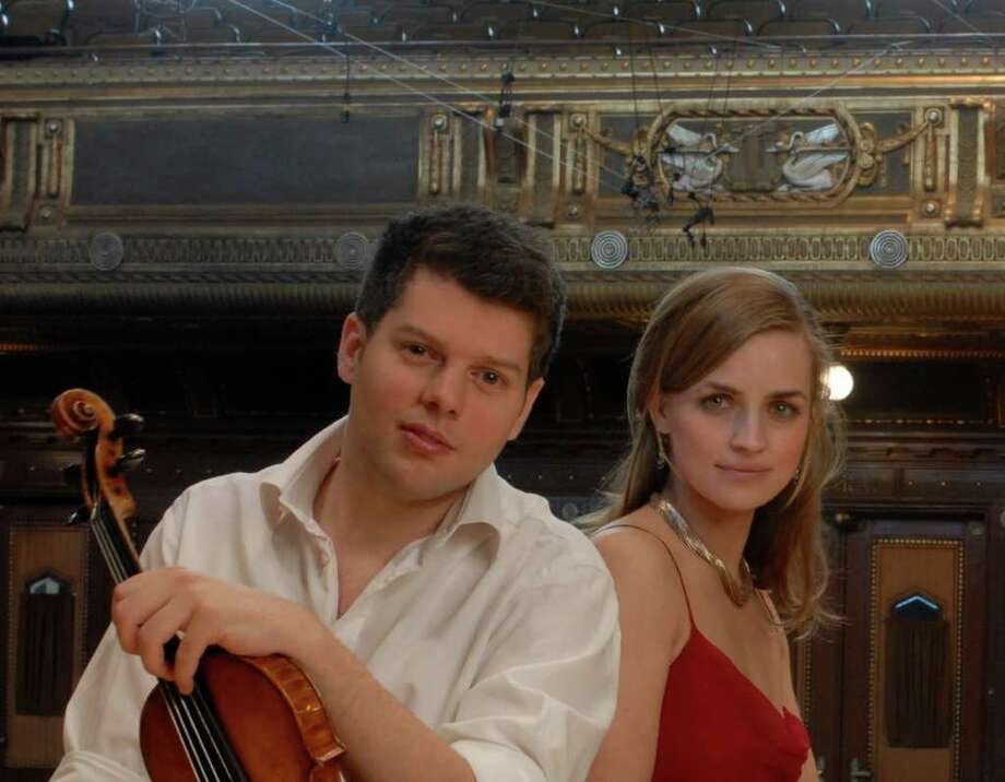 The husband-and-wife duo of violinist Barnabas Kelemen and violist Katalin Kokas are set to perform Mozart's Sinfonia Concertante, K. 364, with the Greenwich Symphony Orchestra for two concerts, March 19 and 20. For ticket information, call 203-869-2664. Photo: Contributed Photo / Stamford Advocate Contributed