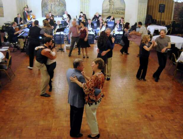 Couples swing dance to the Sonny Carroll Orchestra while its members perform at Sciortino's Restaurant in Brewster on Sunday Feb. 27, 2011. Photo: Lisa Weir / The News-Times Freelance