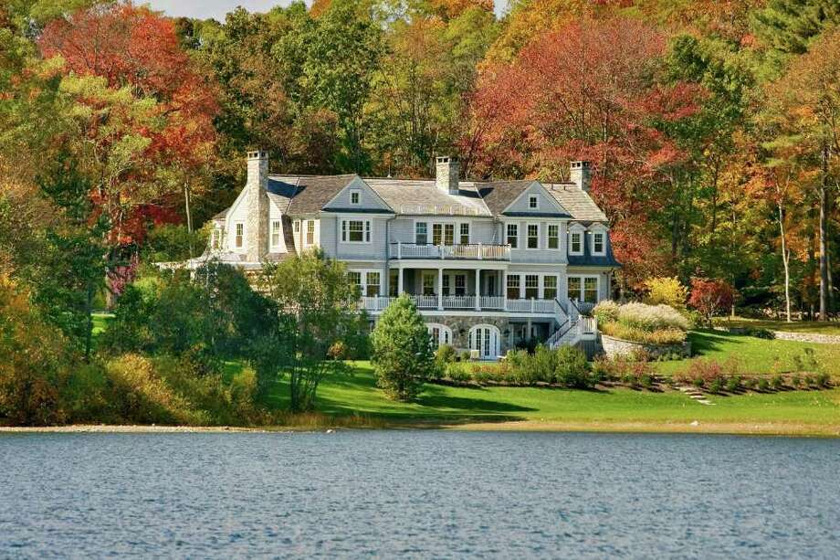 The stunning 12-room, lakefront house is the focal point of a 2.5 acre estate on the Westport-Weston border. Photo: Contributed Photo / Westport News contributed
