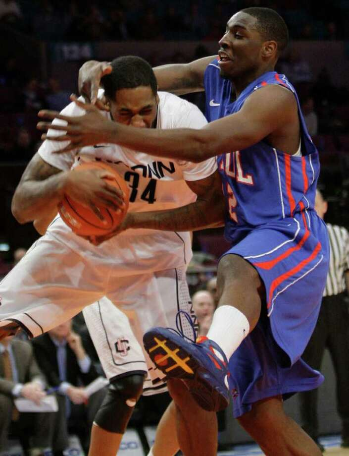 DePaul's Tony Freeland, right, blocks Connecticut's Alex Oriakhi from going to the basket during the first half of an NCAA college basketball game at the Big East Championship, Tuesday, March 8, 2011 at Madison Square Garden in New York.  (AP Photo/Mary Altaffer) Photo: AP