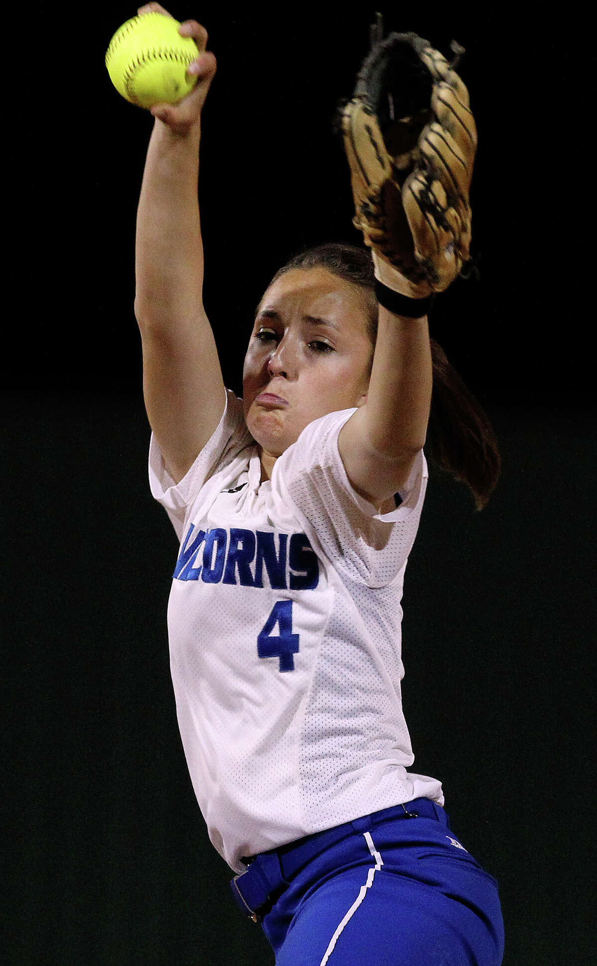 New Braunfels' Amanda Lopez (04) winds up her pitch against Canyon in softball at Canyon High School on Tuesday, Mar. 8. 2011. Canyon defeated New Braunfels, 6-4.