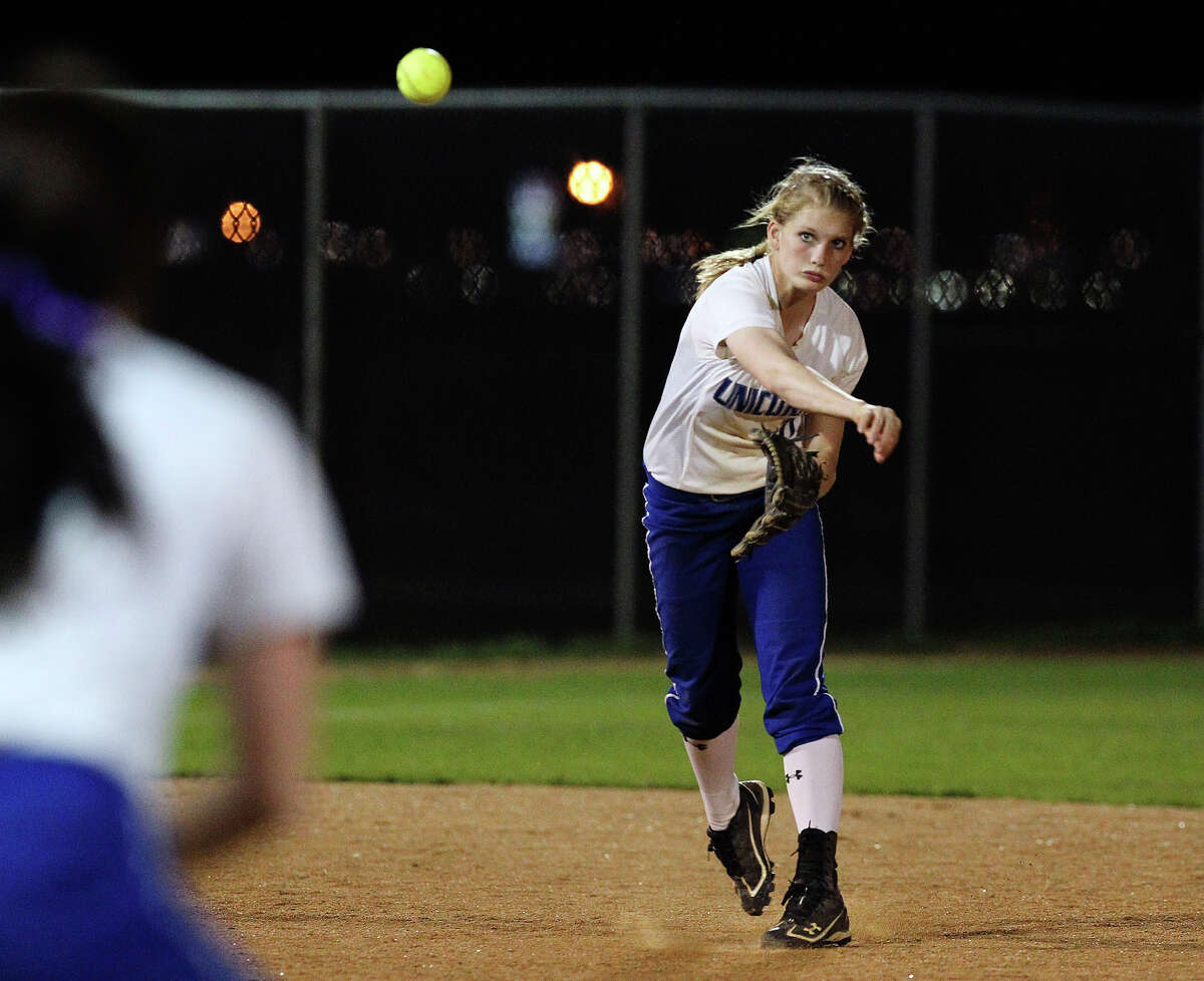 New Braunfels' Mallory Hayden (right) tracks her throw to first base against Canyon in softball at Canyon High School on Tuesday, Mar. 8. 2011. Canyon defeated New Braunfels, 6-4.