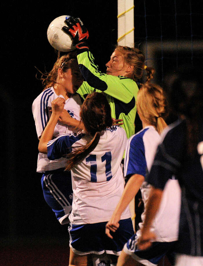 Boerne Champion goalie Morgan Glick makes a save as she is surrounded by Alamo Heights opponents during high-school girls soccer action in Alamo Heights on Tuesday, March 11, 2011. Photo: BILLY CALZADA/gcalzada@express-news.net