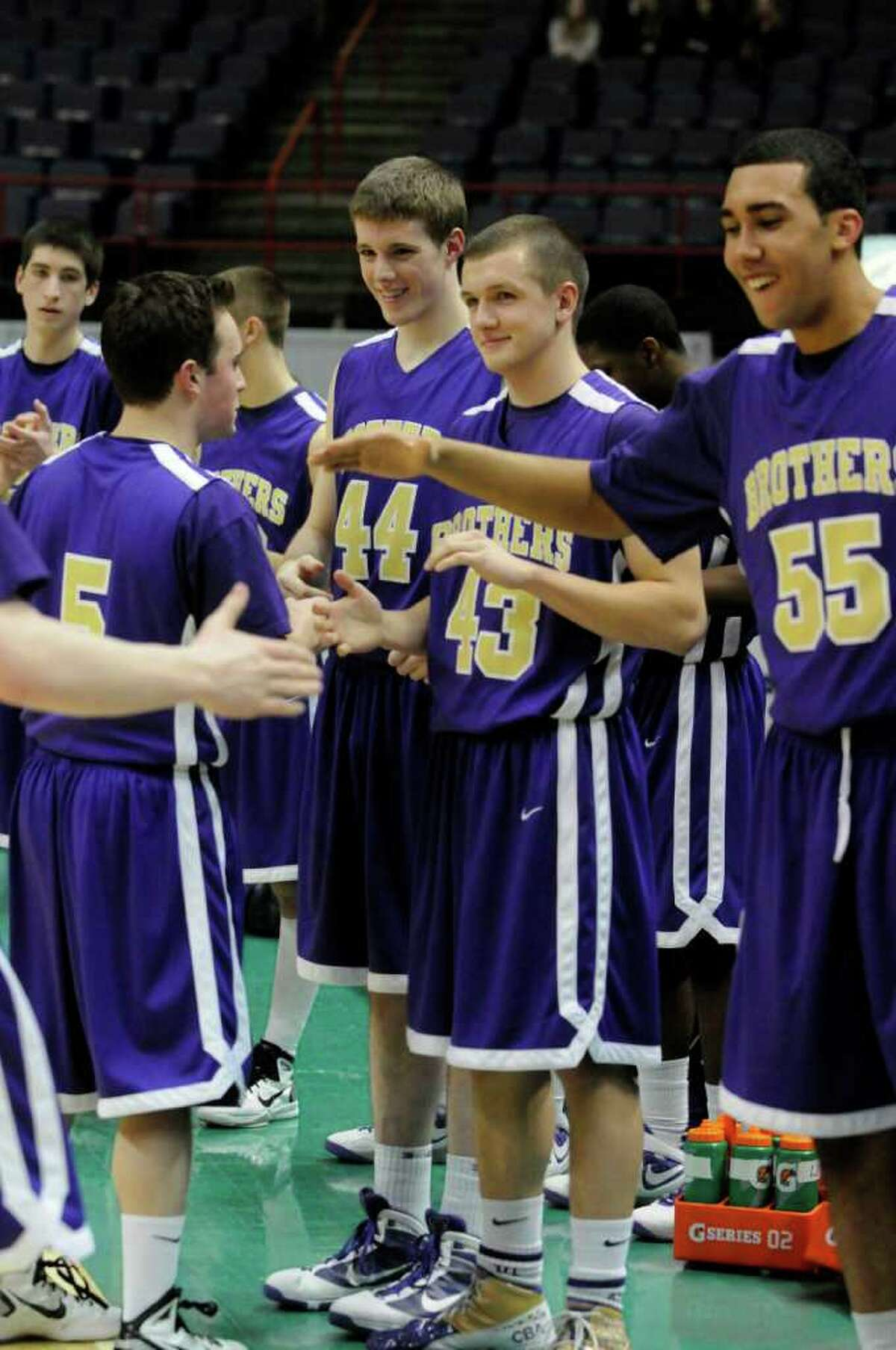 CBA boys varsity basketball team players congratulate each other,left to right, Brendan Dalcol, Chaz Lott, Max Weaver and Nate Robinson , following their Section 2 Class AA boys basketball finals win 69-46 over Bishop Maginn at the Times Union Center in Albany Tuesday March 8, 2011.( Michael P. Farrell/Times Union )