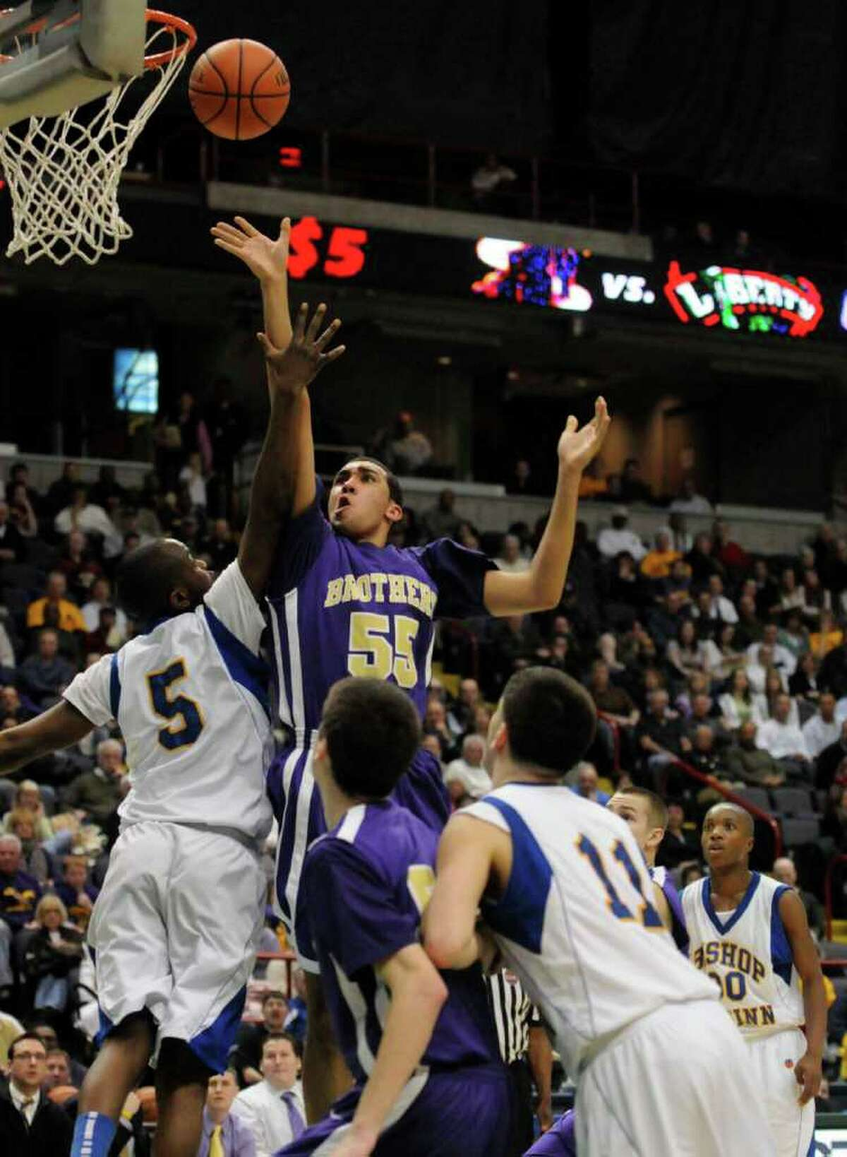 Christian Brothers Nate Robinson puts a shot up during their Section 2 Class AA boys basketball finals win 69-46 over Bishop Maginn at the Times Union Center in Albany Tuesday March 8, 2011.( Michael P. Farrell/Times Union )