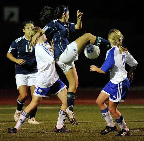 Tori Alaniz of Boerne Champion kicks a goal against Alamo Heights during high-school girls soccer action in Alamo Heights on Tuesday, March 11, 2011. Photo: BILLY CALZADA/gcalzada@express-news.net