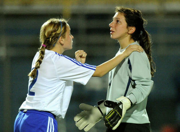 Milla Brusenhan (2) offers encouragement to goalie Chloe Crumley during high-school girls soccer action against Boerne Champion in Alamo Heights on Tuesday, March 11, 2011. Photo: BILLY CALZADA/gcalzada@express-news.net