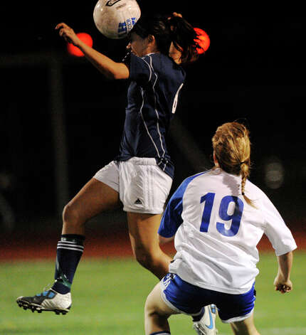 Tori Alaniz, top, of Boerne Champion heads the ball as Hilary Shaw (19) of Alamo Heights watches during high-school girls soccer action in Alamo Heights on Tuesday, March 11, 2011. Photo: BILLY CALZADA/gcalzada@express-news.net