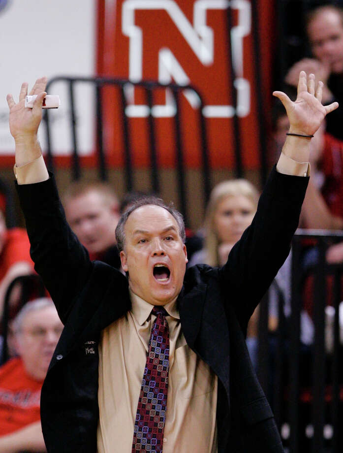 Doc Sadler's Huskers, seeded No. 8, must get a win against OSU and a few more to make the Big Dance. Photo: Nati Harnik/Associated Press