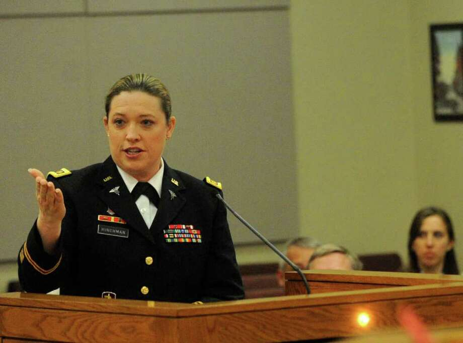 U.S. Army Maj. Samantha Hinchman speaks before the Bexar County Commissioners Court about community psychiatric services and the number of impoverished people that seeks psychiatric treatment in hospital emergency rooms. Photo: BILLY CALZADA / gcalzada@express-news.net